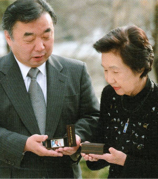本名 まり子さん
